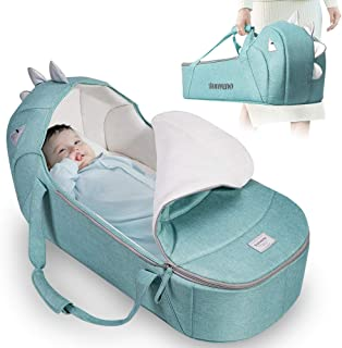 baby in carry cot