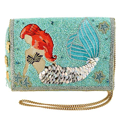 "This gorgeous hand beaded clutch captures the deep blue hues of the ocean, the sparkle of Ariel's fin, as well as her iconic red mane, which is meticulously hand embroidered. Dimensions: 9.5 x 1 x 7"" Strap Drop Length: 23 IN Features: Removable cross..."