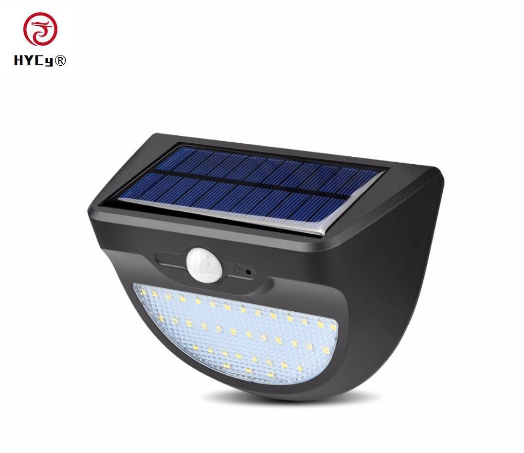 Hycy Panel Solar Cargador Solar LED De Luz Bombilla Jardín Lámpara De Exterior con PIR Sensor De Movimiento Iluminación De Pared Seguridad Camino Iluminación Nocturna: Amazon.es: Hogar