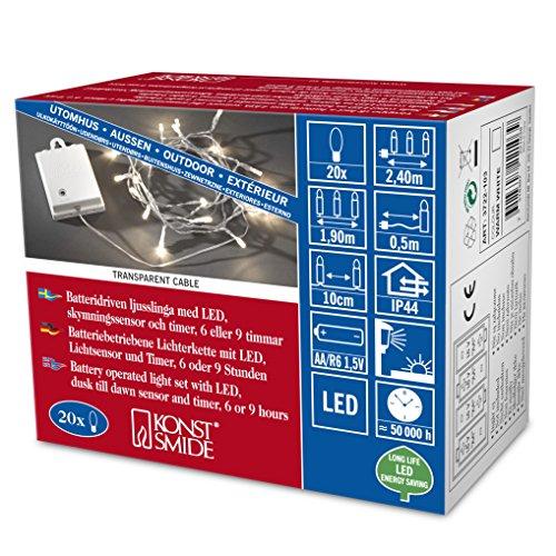 Konstsmide 3722-103 - Catena luminosa LED con interruttore e sensore, timer per 6 e 9 ore, adatta a esterni (IP44), 20 diodi a luce bianca calda, funzionamento a batteria, con cavo trasparente, scatola bianca, 4 pile AA da 1,5 V escluse