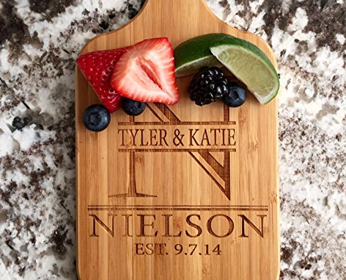 Personalized Engraved Cutting Board with Handle Housewarming and Wedding Gift for Kitchen (5 x 11 Bamboo Paddle Shaped, Nielson Design)