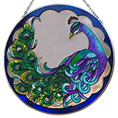 The majestic peacock is captured in an artistic suncatcher for a stunning window display. Hand painted in vivid translucent color includes a metal chain for hanging. Looks beautiful from inside or outside the window. A fantastic addition to any home....