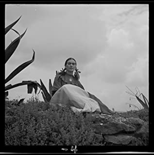 1937 Photo Frida Kahlo (Senora Diego Rivera) seated next to an agave plant, during a photo shoot for Vogue magazine,