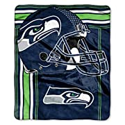 """Features NFL team name and logo Soft and warm raschel fabric; oversized; decorative binding around all edges Measures 50""""W x 60""""L Machine wash cold separately using delicate cycle and mild detergent. Do not bleach. Machine dry separately on gentle cy..."""