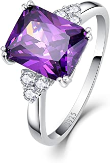 engagement ring with purple side stones