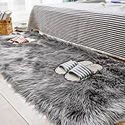 Faux sheepskin mat in grey color.