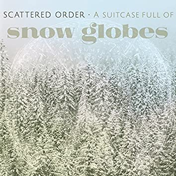 A Suitcase Full of Snow Globes