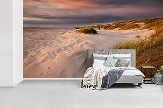 Fotobehang vinyl Zonsondergang op het strand - Zon gaat onder bij de witte zandduinen op het strand breedte 535 cm x hoogt...