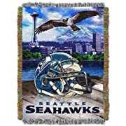 """Features NFL home stadium, team logo, football, and helmet Detailed, woven throw blanket; decorative fringes around all edges; made in America Measures 48""""W x 60""""L Machine wash cold separately using delicate cycle and mild detergent. Do not bleach. M..."""