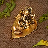 Decorative Ganesha Brass Diya Oil Lamp | Handmade Brass Diya For Festival / Home Decor / Gift Size : 4.5 Inches Length x 3 Inches Width x 3 Inches Height | Weight : 190g | Material : Aluminium Metal with gold finish It is an stylish show piece for yo...