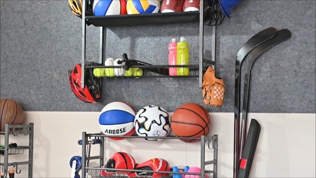 Garage storage system with baskets and hooks