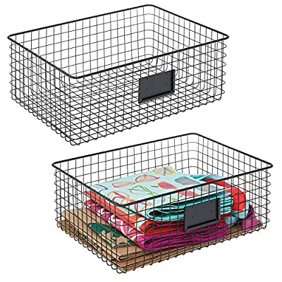 mDesign Farmhouse Decor Metal Wire Food Organizer Storage Bin Baskets with Label Slot for Kitchen Cabinets, Pantry… - PORTABLE: Bins feature open wire design that makes it simple to transport goods from pantry to shelf to table; Includes a convenient slot ready for your personal label; The perfect storage and organizing solution for modern kitchens and pantries; Perfect for snacks, drinks, fruits, vegetables, pastas, soups, canned goods, bottles, cans, cookies, seasoning and flavor packets, macaroni and cheese boxes, pouches, jars, bread, baked goods and many other kitchen pantry items; Set of 2 FUNCTIONAL & VERSATILE: Organize all of your kitchen essentials; Great for dry goods and other kitchen items such as: towels, candles, small appliances and kitchen tools; These also work in the refrigerator or freezer; Classic open wire design offers roomy and easy storage for any room in your home; Use multiple bins side by side for larger spaces or use them individually; Try these in closets, bedrooms, bathrooms, laundry rooms, craft rooms, mudrooms, offices, playrooms, and garages MULTIPLE STORAGE OPTIONS: The perfect solution for organizing a multitude of household items - such as video games, toys, lotions, bath soaps, shampoos, conditioners, linens, towels, laundry needs, craft supplies, school supplies, files and more; The options are endless; Great for dorm rooms, apartments, condos, cabins, RVs, and campers, too; Use this multi-purpose basket anywhere you need to add storage and get organized - living-room-decor, living-room, baskets-storage - 61Kz3JQVxYL. SS400  -