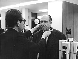 Vintage photo of Man taking measurements of Andreas G. Papandreou, in Paris.