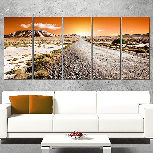 Designart Sunset Desert with Pebble Road Landscape Artwork Canvas Print, 60x28-5 Equal Panels