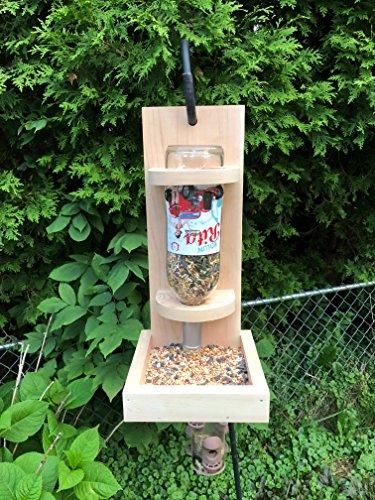 Wine bottle bird feeder, wooden bird feeder or squirrel feeder made from cedar and a repurposed wine bottle.