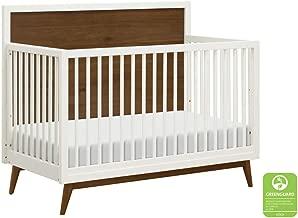 white crib with wood legs