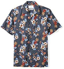 Made in China A vibrant print adds tropical appeal to this casual aloha shirt made with breezy cotton for beach or out-of-office style Standard Fit: Slim and tapered through the waist. This is not a traditional, relaxed hawaiian shirt fit. Order up i...