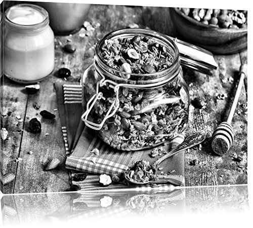 Honing granola in een kruikFoto Canvas | Maat: 60x40 cm | Wanddecoraties | Kunstdruk | Volledig gemonteerd