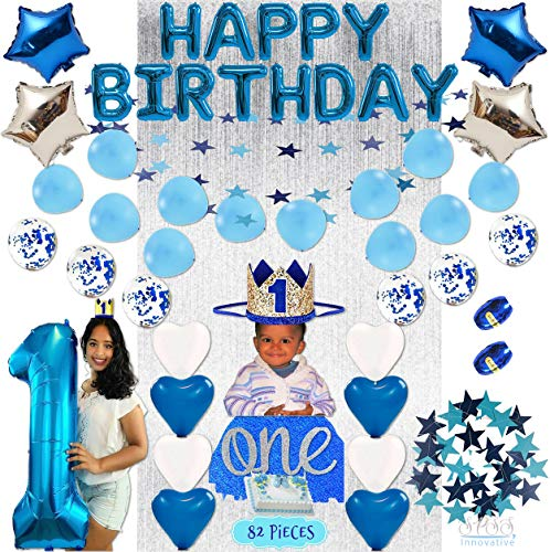 SPSS INNOVATIVE|Baby Boy 1st Birthday Decorations WITH Birthday Crown- First One Birthday Boy 82 Pieces blue, pearl, silver Decorations - Cake Smash Party Supplies Number One Balloon, Cake Topper, Silver Foil Fringe Backdrop Curtain, Happy Birthday Banner, Blue & Silver Star Foil Balloons, Blue and Pearl Heart Balloons, Blue Confetti Balloons, Dark Blue & Light Blue Star Banner, Decoraciones para el primer cumpleaños del bebé con corona de cumpleaños