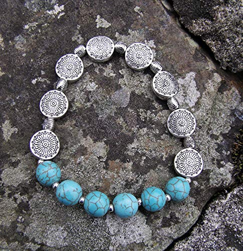 Turquoise stone bracelet with arrtactive silver discs beads.