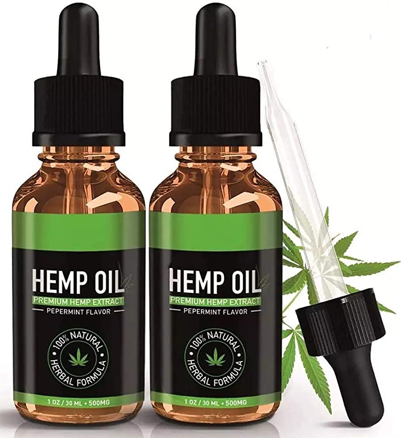会計士付添人座るHEMP OIL FOR PAIN RELIEF ヘンプオイル PEPPERMINT FLAVOR ORGANIC