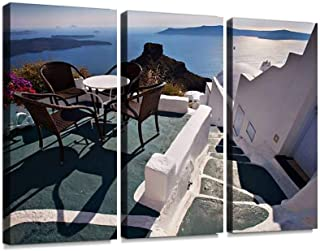 Table, chairs and flowers on Santorini terrace, overlooking aegean Wall Artwork Exclusive Photography Vintage Abstract Paintings Print on Canvas Home Decor Wall Art 3 Panels Framed Ready to Hang