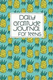 green covered daily gratitude journal with florals