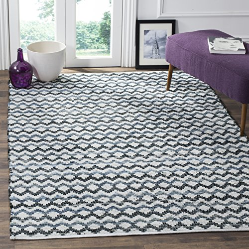 White rug with blue and gray geometric pattern
