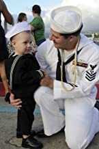 October 29 2010 - US Navy sailor hugs his son during a homecoming celebration for the Los Angeles-class submarine USS Louisville at Joint Base Pearl Harbor-Hickam Hawaii Poster Print (22 x 34)