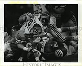 Historic Images - 1987 Press Photo Football Player Eric Dickerson of Rams Dives Into Jackie Slater
