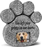 A stone paw print with a picture of a Golden Retriever