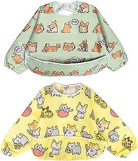 Långärmad vattentät haklapp till baby med hundar och katter som mönster.