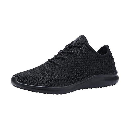 black tennis shoes with black soles