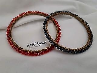 Bracciale rigido dorato con mezzi cristalli rosso e nero