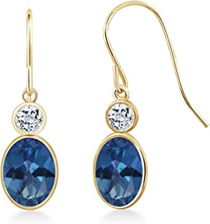 Gem Stone King 2.18 Ct Oval Royal Blue Mystic Topaz White Topaz 14K Yellow Gold Earrings