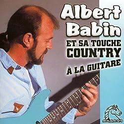 Et Sa Touche Country a la Guitare [Import]
