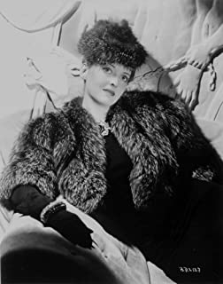 Bette Davis Posed with Hand on the Lap in Black Fur Coat and Black Dress with Black Gloves Photo Print (24 x 30)