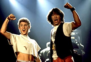 Posterazzi Bill and Ted's Excellent Adventure Alex Winter Keanu Reeves 1989 Raised Fist Photo Poster Print (20 x 16)