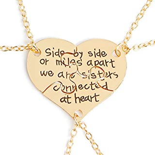 sisters connected by the heart necklace