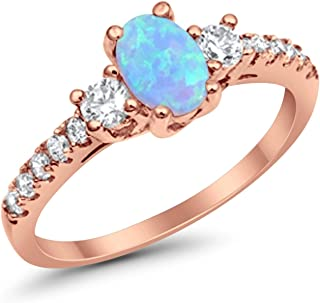 925 Sterling Silver Rose Tone Rhodium Plated Ring Oval Cut Lab Created Light Blue Opal Round CZ Accent