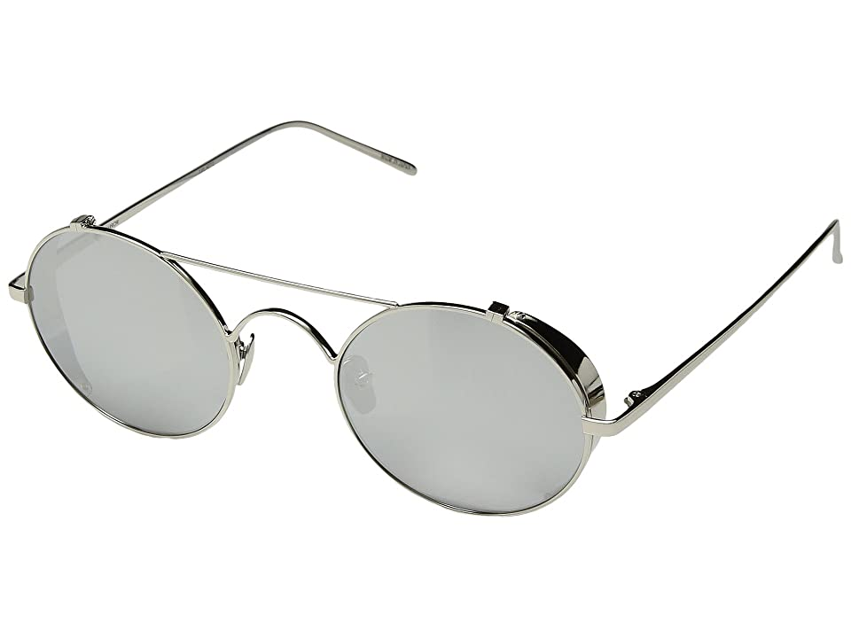 Feel out the vibes in the room behind the unique look of these Linda Farrow Luxe sunglasses. 24kt white gold platinum frame and temples with side blinders. Monochromatic nylon polarized lenses offer 100% UVA and UVB protection. Double bridge. Clear adjustable nose pads. Brand name at inner temple. Most complementary face shapes: oval  square. Protective case included. Made in Japan. Measurements: Eye Size: 46 mm Bridge: 25 mm Temple Size: 147 mm Weight: 0.6 oz