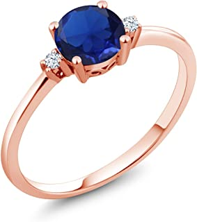 10K Rose Gold Engagement Solitaire Ring set with 0.78 Ct Round Blue Simulated Sapphire and White Created Sapphires (Available 5,6,7,8,9)