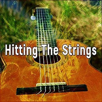 Hitting The Strings