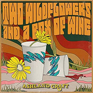 Two Wildflowers And A Box Of Wine