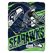"""Features NFL team helmet, name and logo in a distressed print Soft and warm micro raschel fabric; decorative binding around all edges Measures 46""""W x 60""""L Machine wash cold separately using delicate cycle and mild detergent. Do not bleach. Machine dr..."""