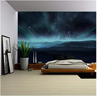 wall26 - Starry Night Sky with Aurora Over The Hills - Removable Wall Mural | Self-Adhesive Large Wallpaper - 66x96 inches