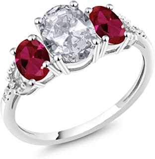 10K White Gold Diamond Accent 3-Stone Engagement Ring set with 2.35 Ct Oval White Topaz Red Created Ruby