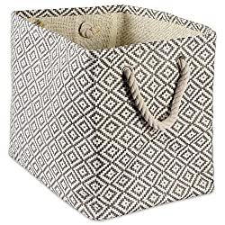 square woven basket with a white and tan pattern and rope handles