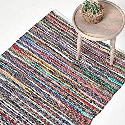 Brand: Homescapes. 70 x 120 cm 27 x 47 Inch (approximately) size. 100% cotton recycled fabric cuttings are used to weave this rug. Manufactured by Homescapes. Hand woven on traditional handlooms in India . This rug is very eco-friendly with a very lo...