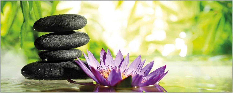 Wallario Glasbild Steinstapel in schwarz mit Blaumenblüte in lila - 50 x 125 cm in Premium-Qualitt  Brillante Farben, freischwebende Optik